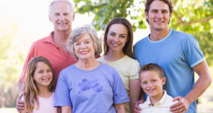 Extended family standing in park smiling